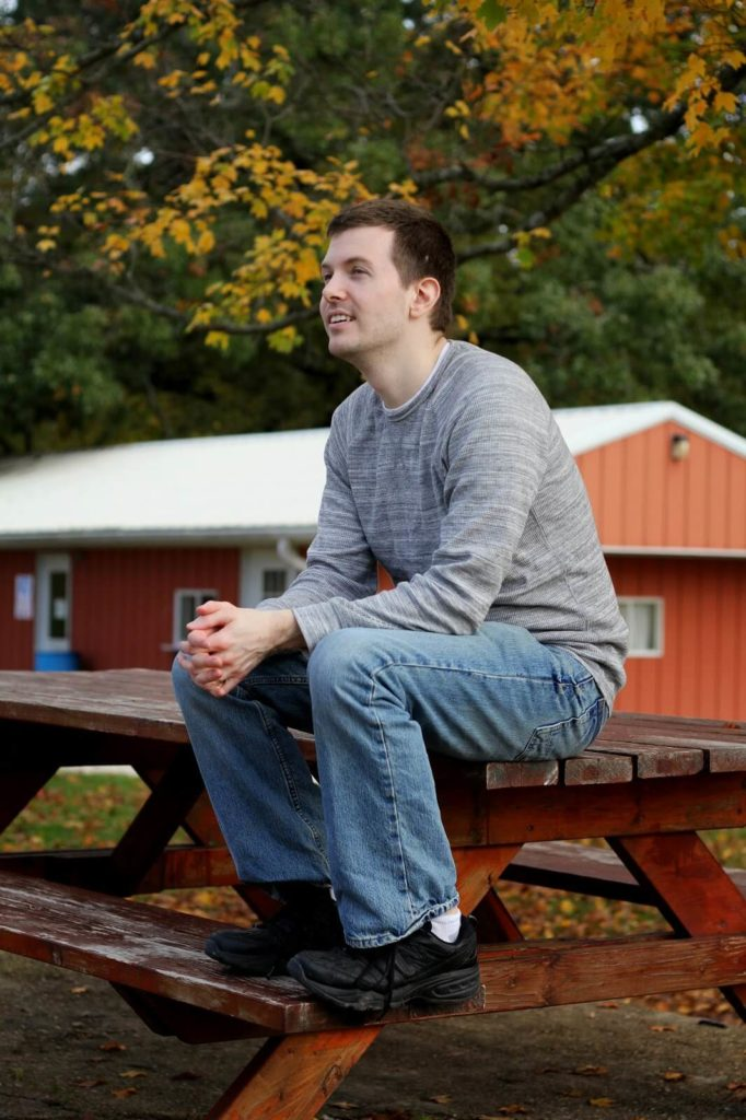 man sitting on picnic table