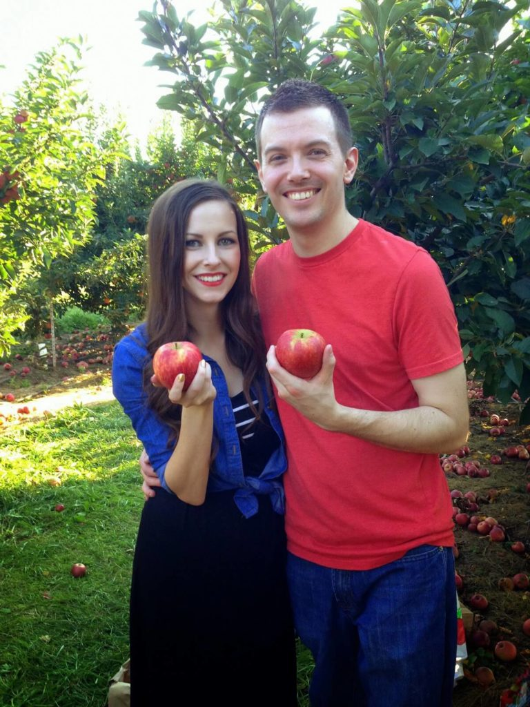 married couple going apple picking