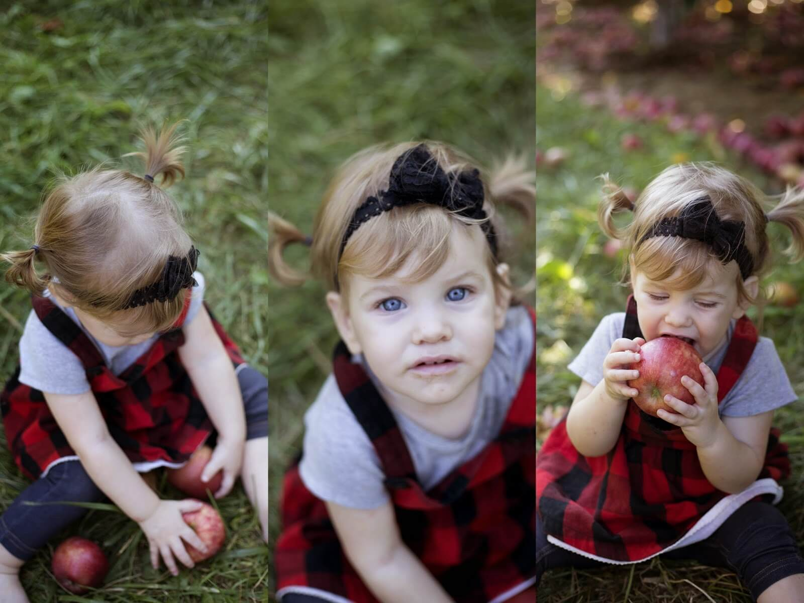 cute baby girl eating apple