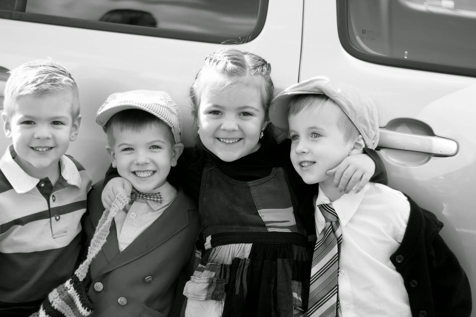 black and white picture of 4 kids