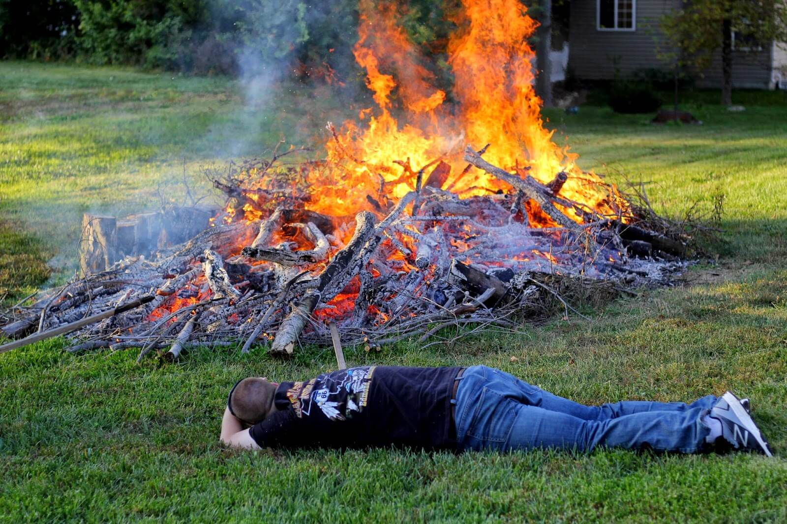 laying down to stay cool at bonfire