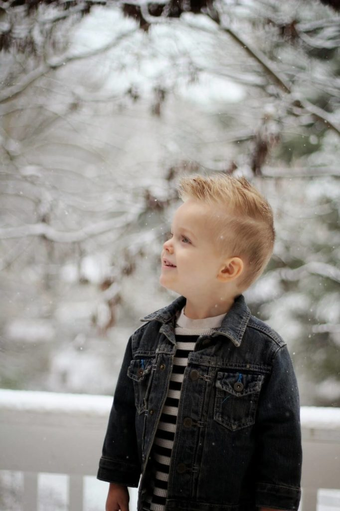 young boy with snowy background