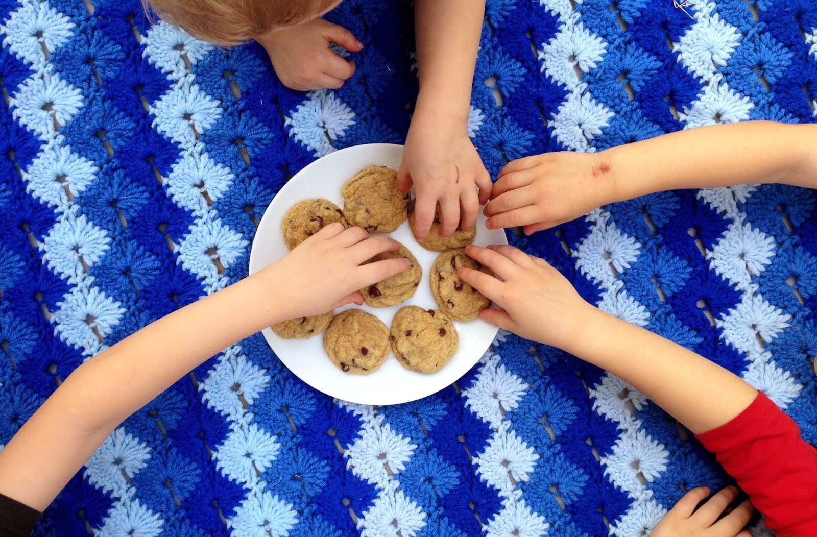 little hands grabbing cookies