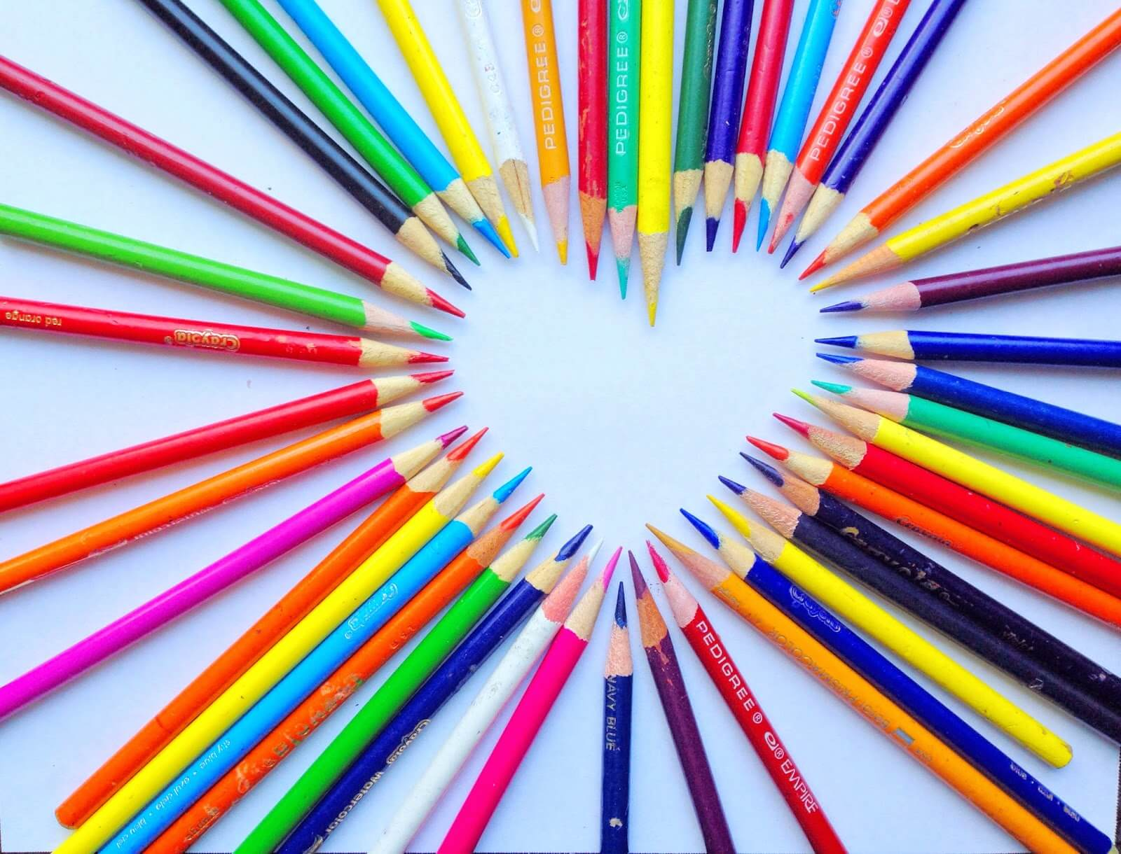 colorful heart shape made out of colored pencils