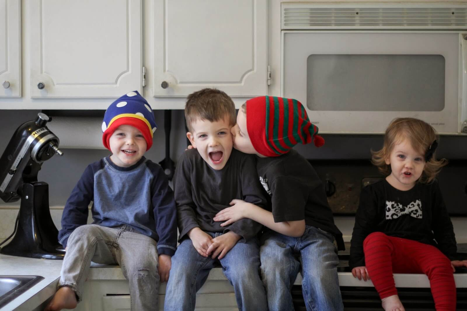four kids sitting funny