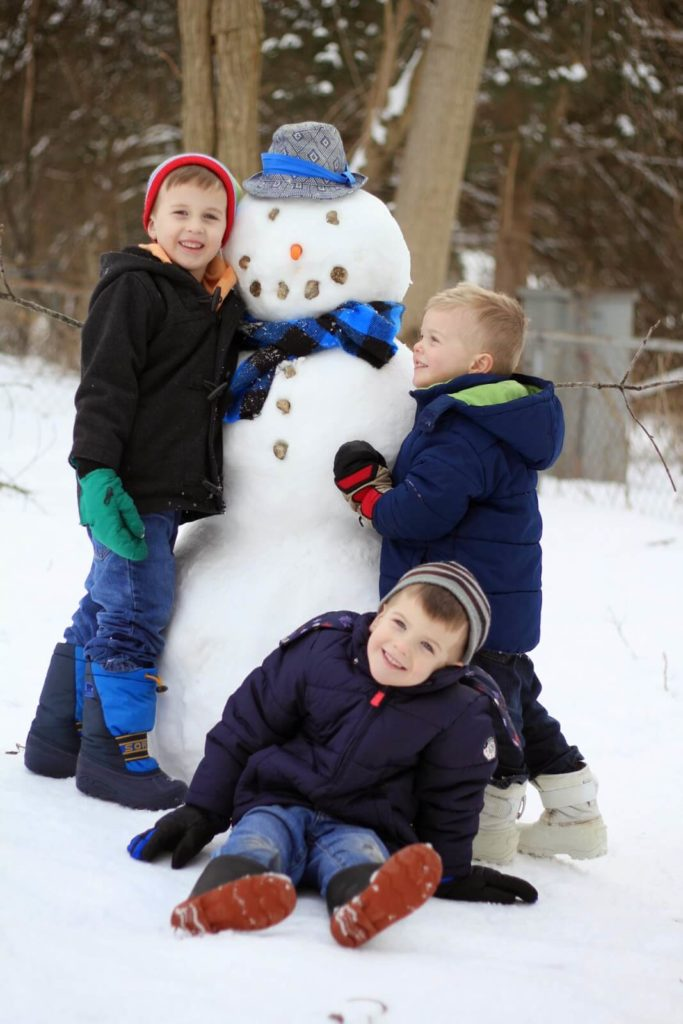 kids posing with snowman 2