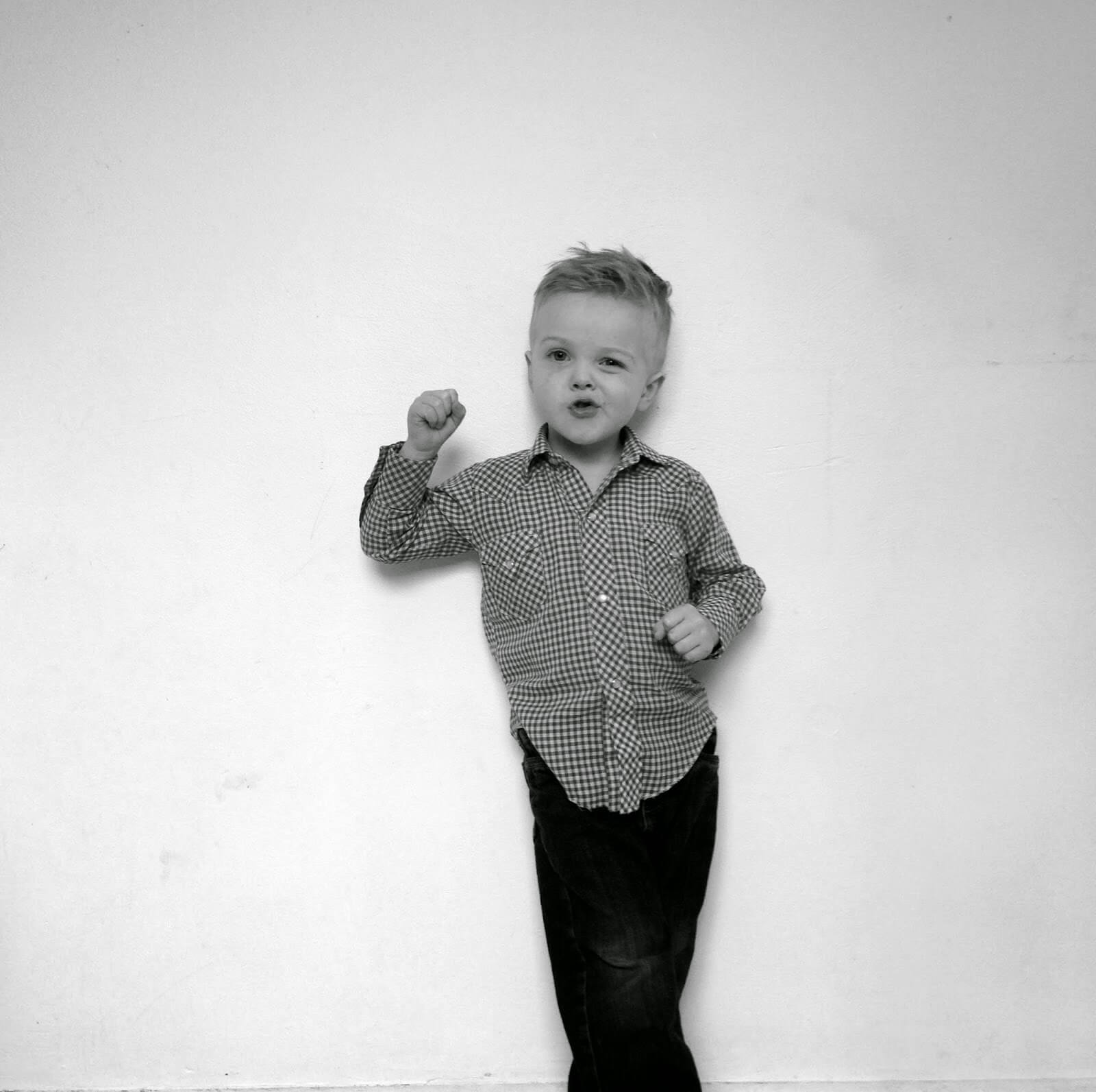funny pose from little boy