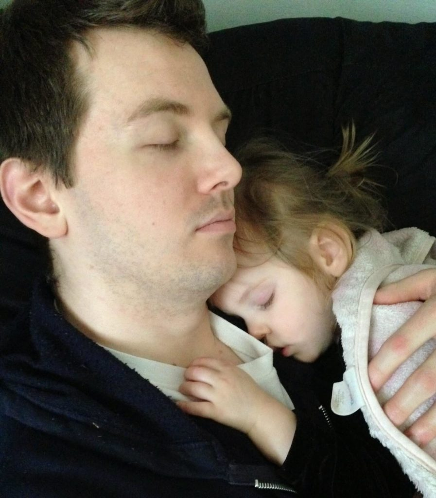 father and girl sleeping