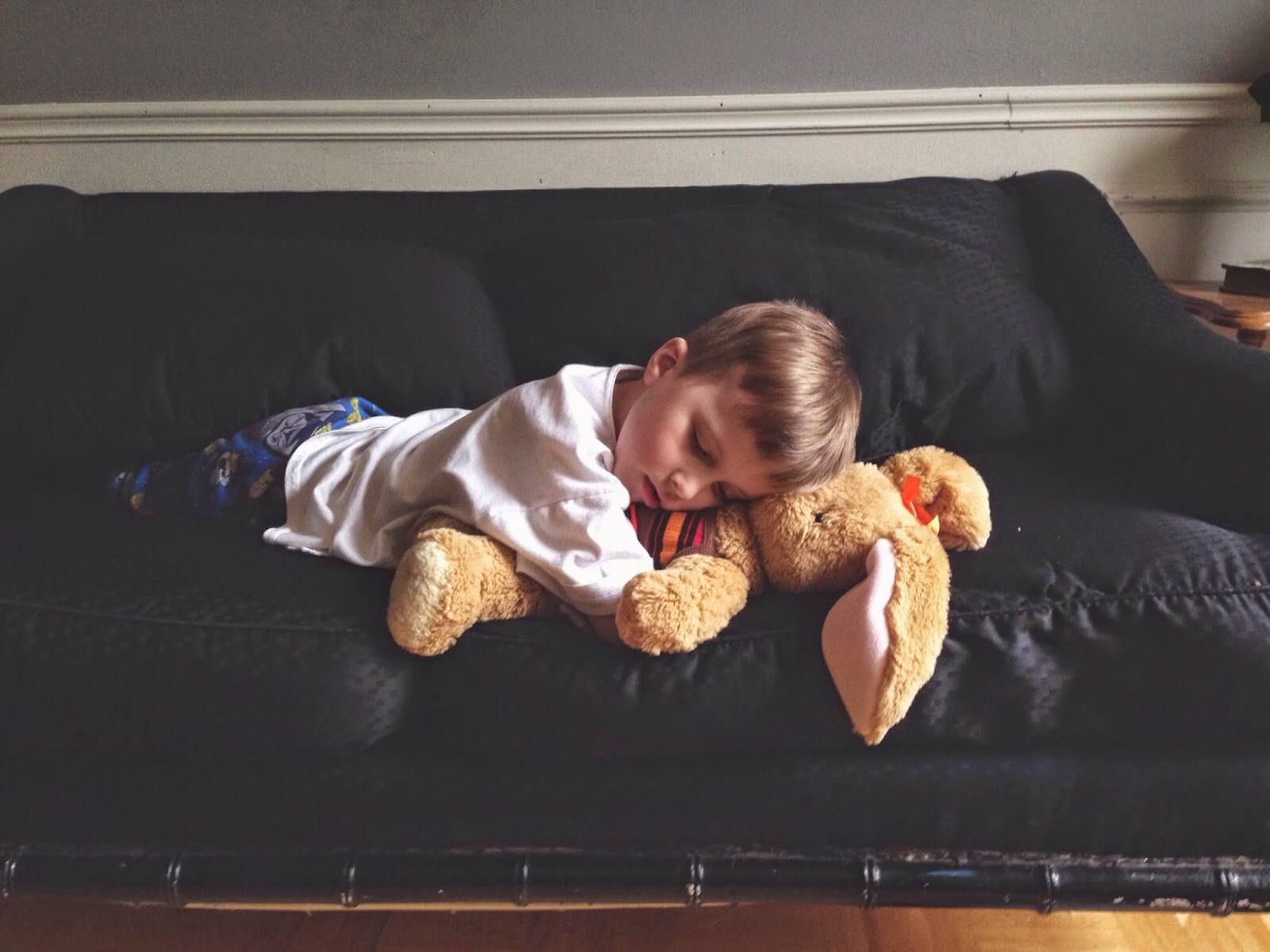 boy napping with stuffed animal