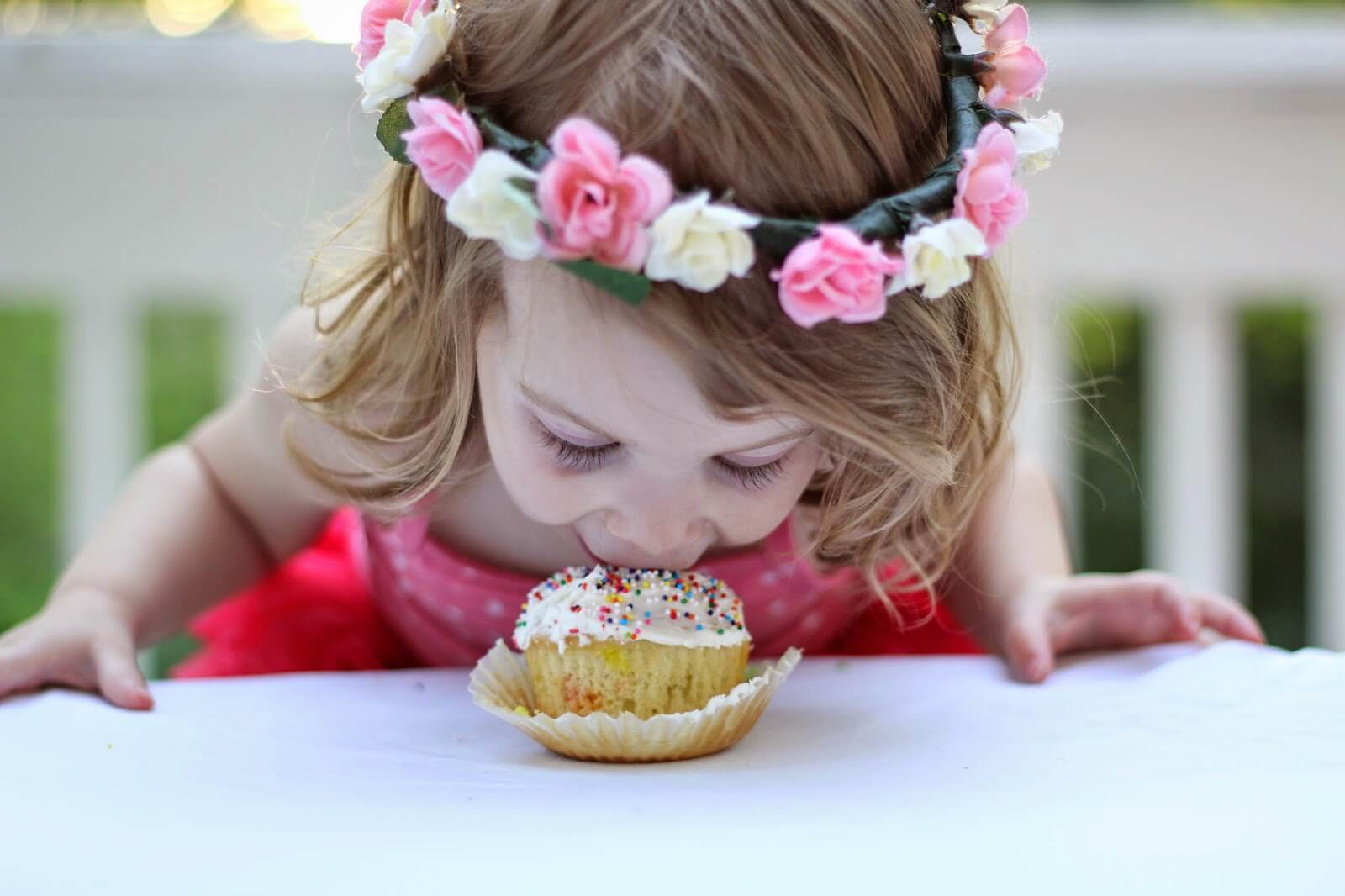 cute little girl eating cupcake