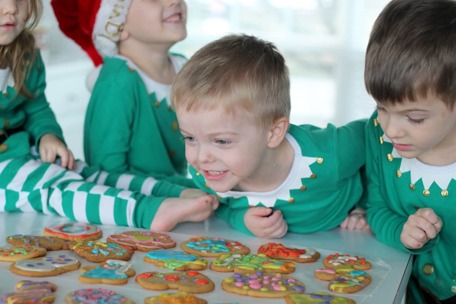 children looking at christmas cookies