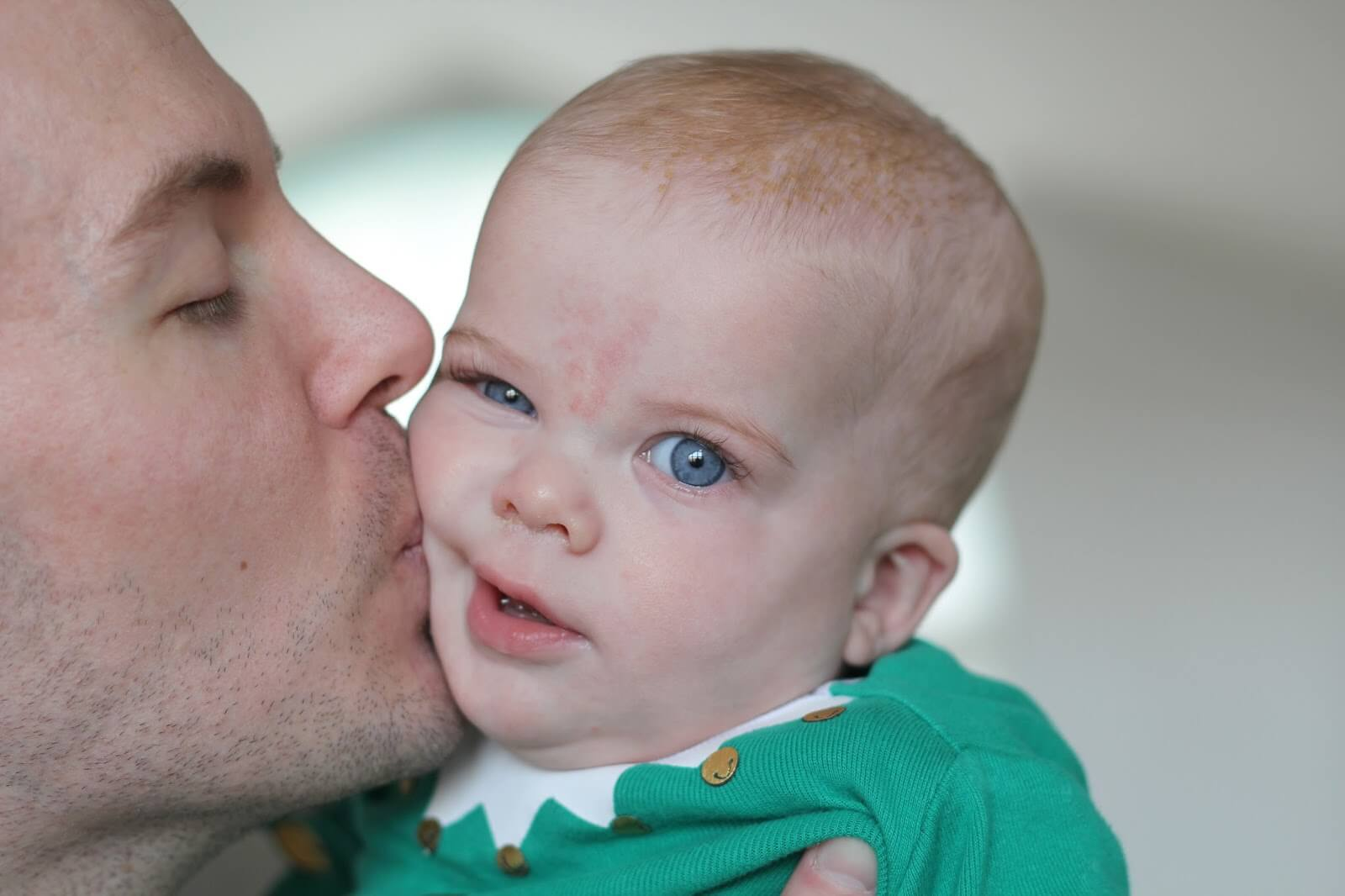dad kissing baby, father kissing son