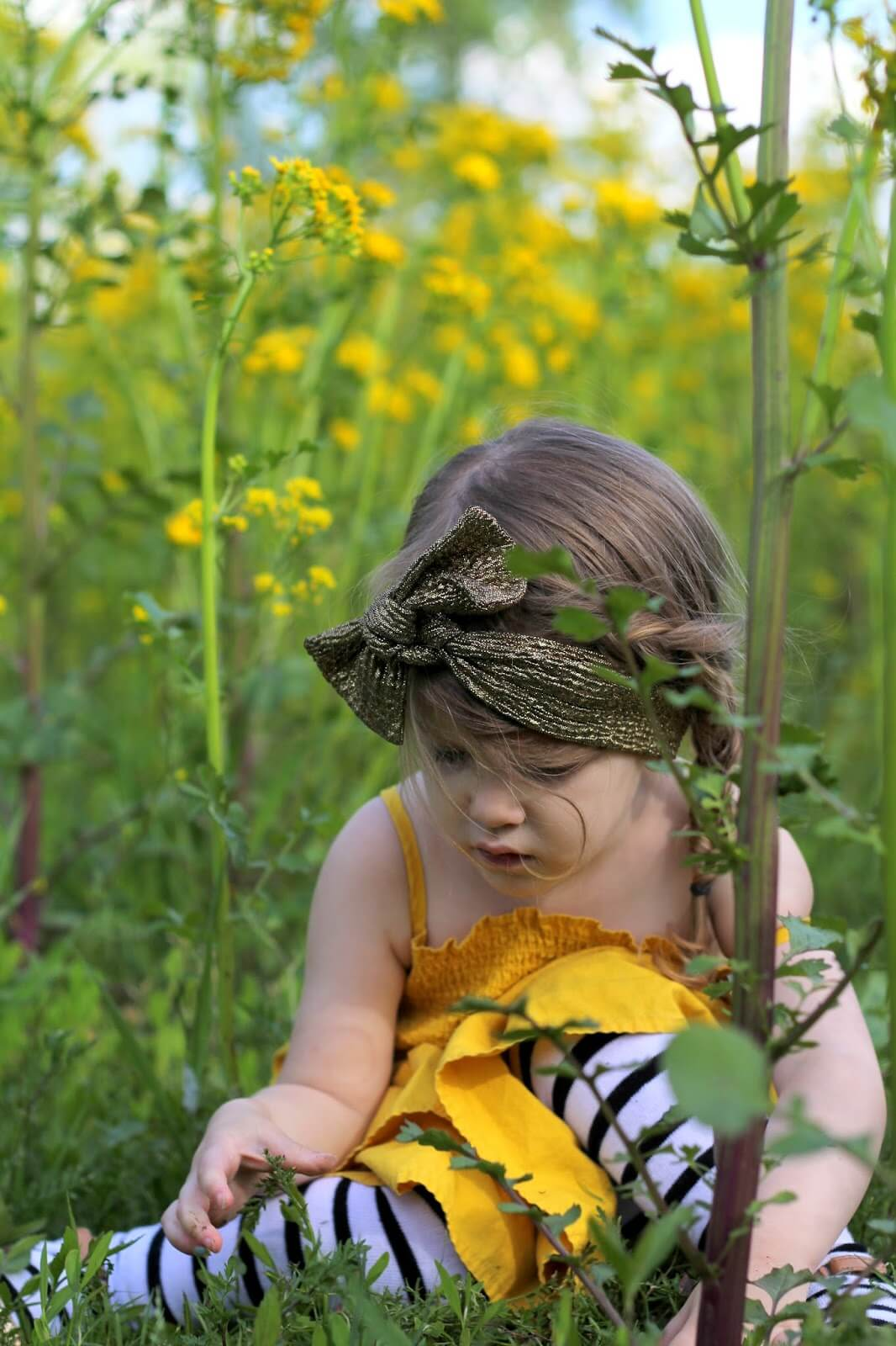 a1db5b0be6c young girl in yellow dress in yellow flowers