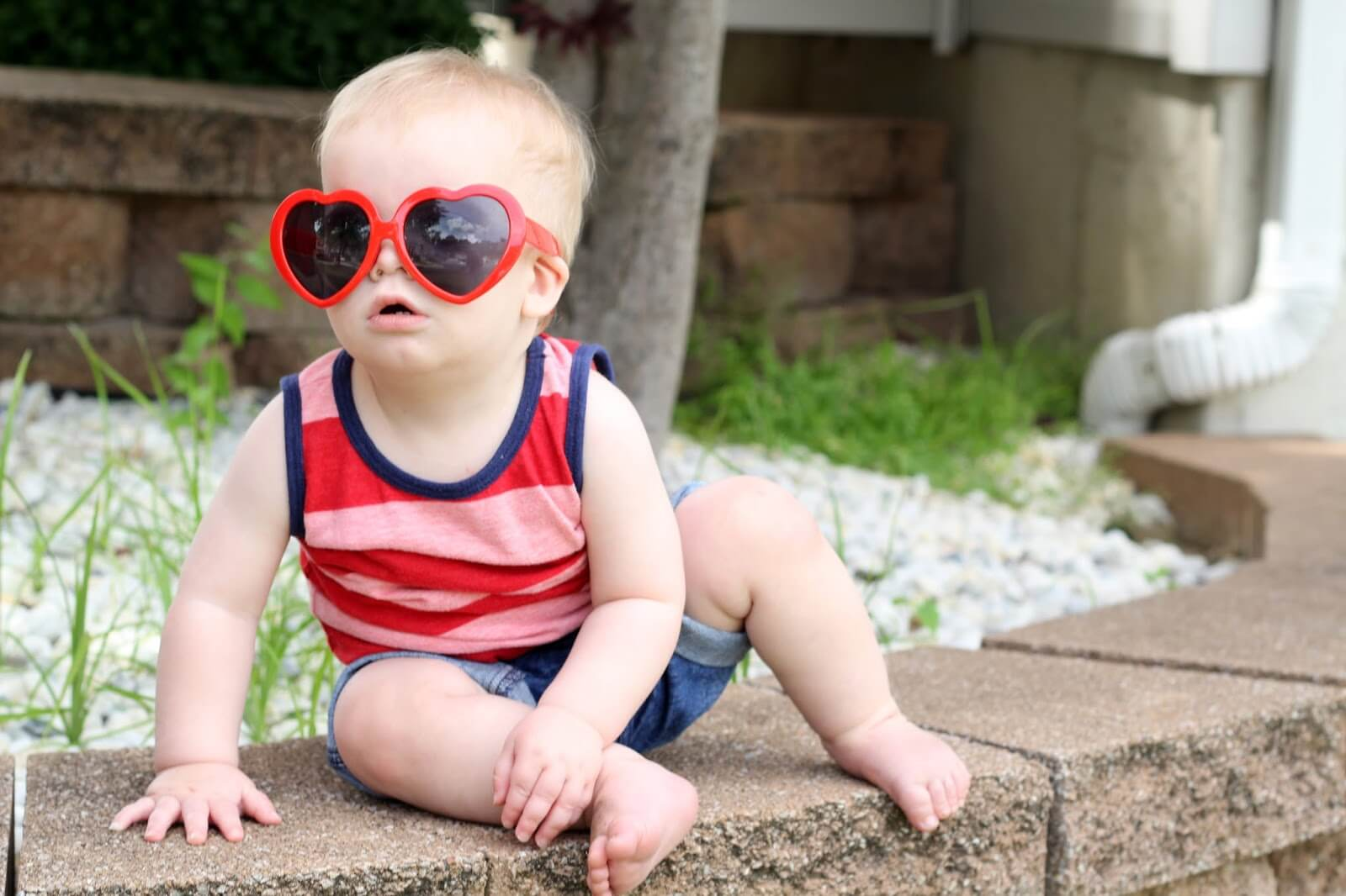 baby with heart sun glasses