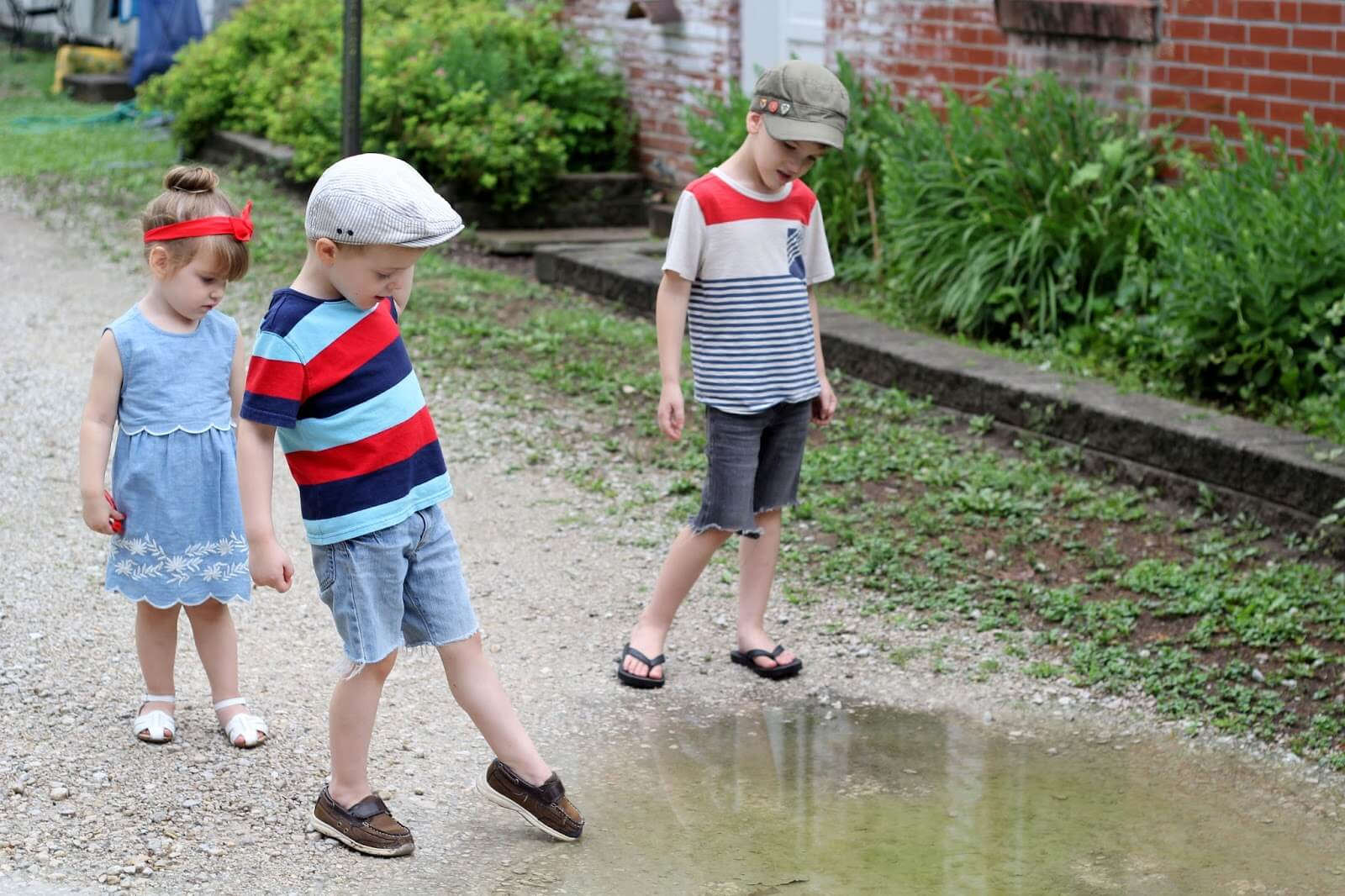 Kids and a puddle