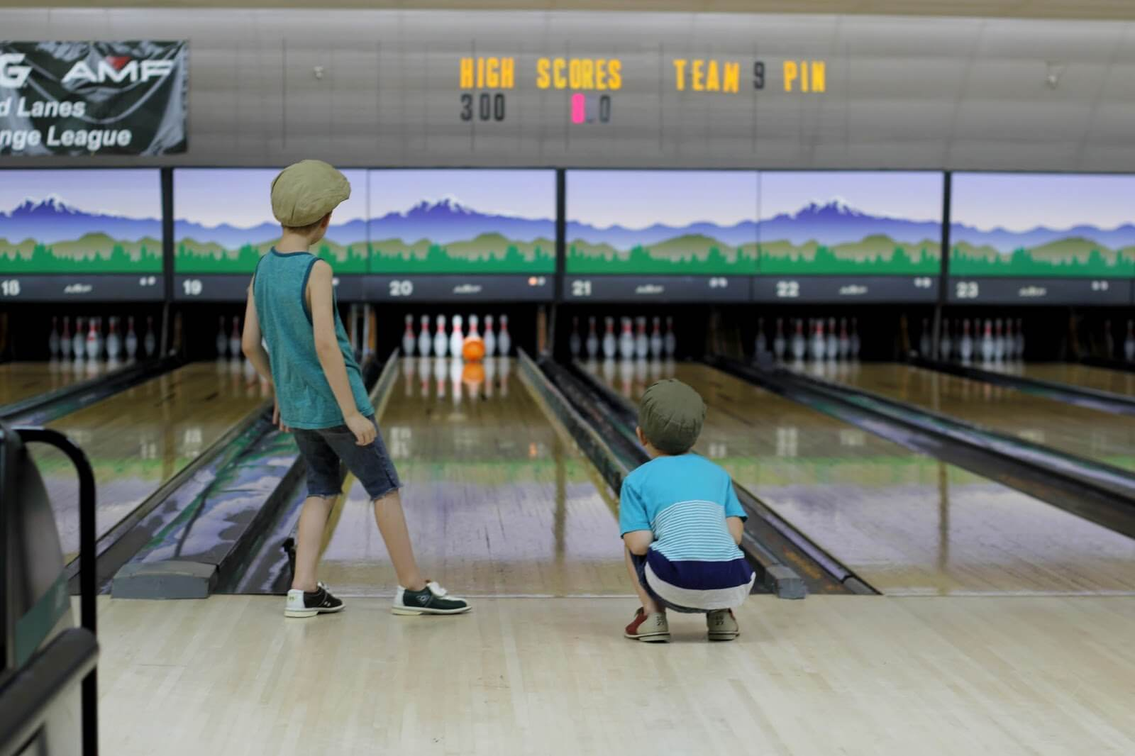 boy and younger brother bowling