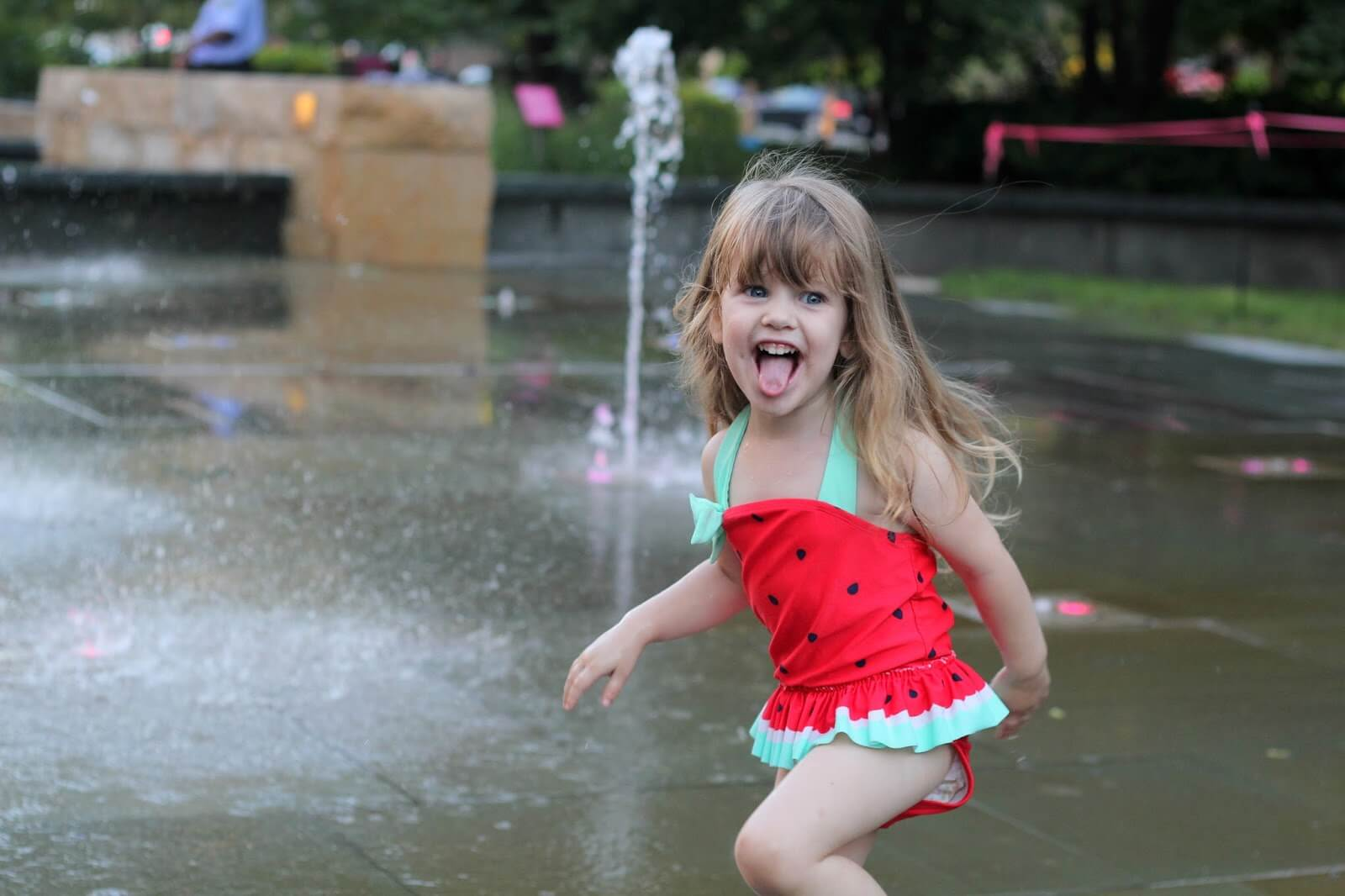 toddler girl in watermelon swimsuit