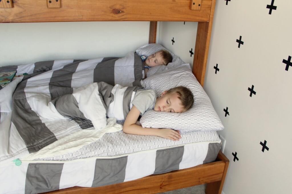 kids sleeping in bed